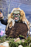 Carnival parade with carved wooden mask. Bad Hindelang, Germany - Februar 15, 2015: Unknown people participate at the annual public carnival parade through the Royalty Free Stock Images