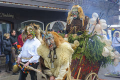 Carnival parade with carved wooden mask. Bad Hindelang, Germany - Februar 15, 2015: Unknown people participate at the annual public carnival parade through the Stock Images