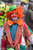 Carnival parade with clown. Bad Hindelang, Germany - Februar 15, 2015: Unknown person participates at the annual public carnival parade through the streets of Stock Images
