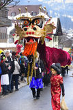 Carnival parade with colorful dragon. Bad Hindelang, Germany - Februar 15, 2015: Unknown persons participate at the annual public carnival parade through the Stock Image