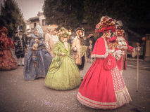 Carnival Parade with original typical Venetian masks. Royalty Free Stock Image