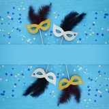 Carnival party celebration concept with masks blue wooden background. Top view. Carnival party celebration concept with masks blue wooden background. Top view royalty free stock images