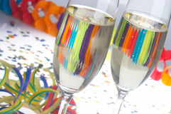 Carnival-Party - Faschingsfeier. 2 Glasses of Sparkling Wine on Carnival - 2 Sektfloeten zu Fasching stock photos