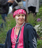 Carnival party girl. Photo of a party carnival girl with bandana headscarf and face painting attending the samba pelo mar concert at the whitstable castle Stock Image