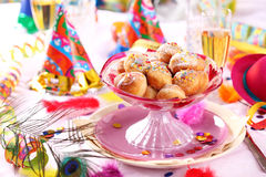 Carnival and party place setting. With small berliners (fried doughnut Stock Images