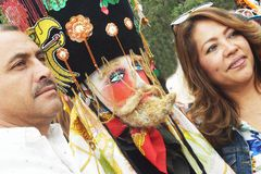 SELFIES WITH `CHINELO`, TEPOZTLAN`S CARNIVAL, MEXICO. In the carnival, people like to take selfies with `chinelos`-mockery of the Spaniards- in the streets of Stock Photo