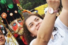 SELFIES WITH `CHINELO`, TEPOZTLAN`S CARNIVAL, MEXICO. In the carnival, people like to take selfies with `chinelos`-mockery of the Spaniards- in the streets of Royalty Free Stock Image