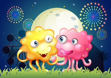 A carnival with a pink and a yellow monster Royalty Free Stock Photo