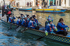 Carnival procession on the Cannaregio Canal on January 24, 2016. VENICE, ITALY - JANUARY 24, 2016: Carnival procession on the Cannaregio Canal on January 24 Royalty Free Stock Photos