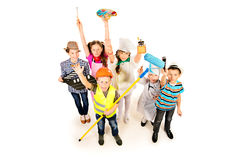 Carnival of professions. A group of children dressed in costumes of different professions. Isolated over white Royalty Free Stock Image