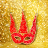 Carnival red mask on gold abstract background Stock Images