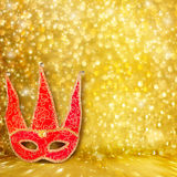Carnival red mask on gold abstract background Royalty Free Stock Photography