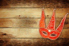Carnival red mask on wooden background Royalty Free Stock Photo