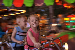 Carnival Ride. A young girl and her brother take a ride at a carnival Royalty Free Stock Image