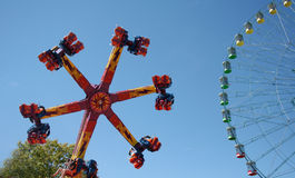 Carnival Ride. A carnival ride turns in circles against the blue sky Royalty Free Stock Photography