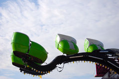 Carnival ride (green). Empty cars of a green carnival ride (octopus royalty free stock photography