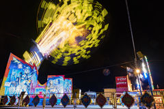 Carnival ride high in the air at night Stock Photo