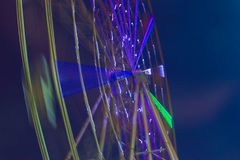 Carnival ride showing a spinning ferris wheel in action Stock Photos