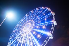 Carnival ride showing a spinning ferris wheel in action Stock Image
