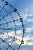 Carnival ride showing a spinning ferris wheel in action Stock Photo