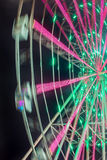 Carnival ride showing a spinning ferris wheel in action Stock Images
