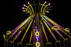 Carnival Ride. YoYo carnival swing ride illuminated at night Stock Photography