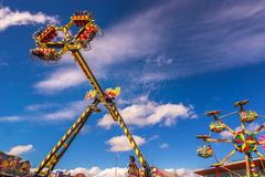 Carnival rides against blue skies Royalty Free Stock Photos