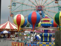 Carnival Rides at Coney Island, New York City. These are wildly-painted carnival rides waiting for customers at New York City`s Coney Island royalty free stock photos