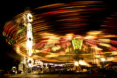 Carnival rides at night Royalty Free Stock Photo