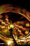Carnival rides at night Stock Photos