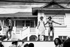 Carnival sexy group 3. Revellers entertaining while closing out J'Ouvert morning celebrations during Trinidad Carnival in Port Of Spain Trinidad Royalty Free Stock Photography