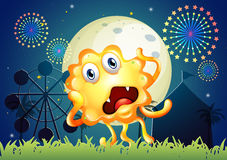 A carnival with a shocked orange monster Royalty Free Stock Photography