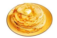 Pancakes or Russian Blintzes on white background. Selective focus. Carnival, Shrovetide, pancake week, shrove, pancake day. a stack of pancakes on a plate Royalty Free Stock Photo
