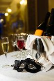 Carnival still life. Carnival mask with a glass of champagne Stock Photo