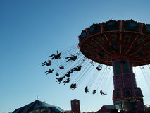 Carnival Swing. Ride, silhouette at dusk stock photo