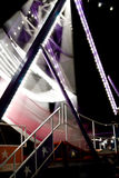 Carnival swing boat. A swing boat in action at night time in a carnival festival royalty free stock image