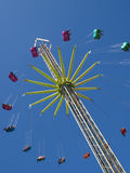 Carnival swing ride. A carnival swing ride on a sunny day Royalty Free Stock Photo