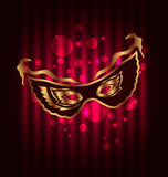 Carnival or theater mask on glowing background Royalty Free Stock Photo