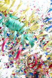 Carnival time. Confetti and streamers to celebrate carnival royalty free stock photography