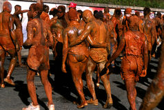 Carnival in Tobago. People covered with mud, celebrating Carnival in Tobago. Mud, oil, paint or other are used for the Monday Carnival Stock Photography