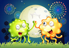 A carnival with two very happy monsters Stock Photography