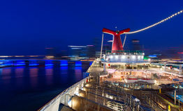 Carnival Valor cruise ship is docking in the central cruise terminal. Over 3,000 guests are returning after 7 days voyage. Royalty Free Stock Image