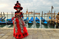 Carnival of Venice. An unidentified masked person in costume in St. Mark's Square during the Carnival of Venice on March 7, 2011