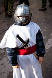 CARNIVAL IN VEVCANI, MACEDONIA. VEVCANI, MACEDONIA - JANUARY 13, 2012: A boy dressed up as a knight during the Vevcani Carnival in southwestern Macedonia Stock Photo