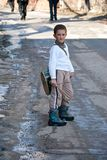 CARNIVAL IN VEVCANI, MACEDONIA. VEVCANI, MACEDONIA - JANUARY 13, 2012: A boy in a traditional Macedonian folk costume with a drum during the Vevcani Carnival in Stock Photography
