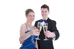Carnival: young couple isolated on white drinking champagne Royalty Free Stock Photo