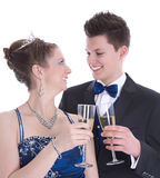 Carnival: young couple isolated on white drinking champagne Stock Image