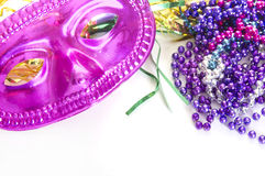 Carnivale mask and beads Royalty Free Stock Images