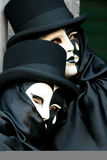 Carnevale Masquerade. A pair black and white Carnevale Masquerade costume from Carnevale 2009 in Venice, Italy Royalty Free Stock Images