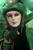 Carnevale Masquerade Close Up. A Carnevale Masquerade costume in gold and green from Carnivale 2009 in Venice, Italy